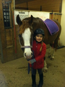 Joanne's horse Kizzes with a friend's daughter, Petra.